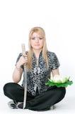 Beautiful woman sitting in lotus pose Stock Photography