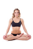 Beautiful woman sitting in lotus position Royalty Free Stock Photo