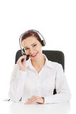 Beautiful woman sitting with microphone and headphones. Royalty Free Stock Images