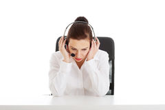 Beautiful woman sitting with microphone and headphones. Stock Photos