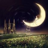 Beautiful woman sitting on moon Royalty Free Stock Photography