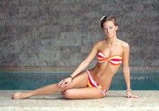 beautiful woman sitting near the pool Stock Photo