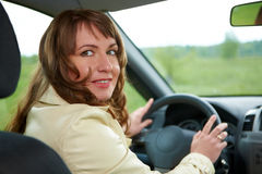 Beautiful woman sitting in the new car Stock Photo