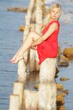Beautiful woman sitting on old wooden bridge Stock Photography