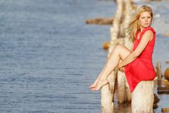 Beautiful woman sitting on old wooden bridge Royalty Free Stock Image