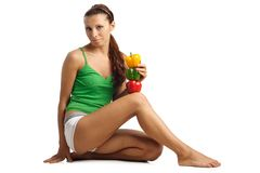 Beautiful woman sitting with pepper Stock Photography
