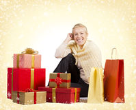 Beautiful woman sitting with presents Royalty Free Stock Photos