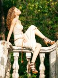 Beautiful woman sitting on railing Royalty Free Stock Images
