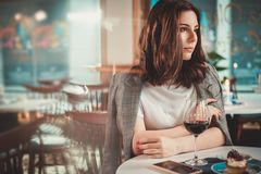 Beautiful woman sitting at the restaurant stock photography