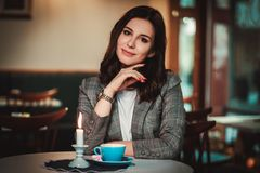 Beautiful woman sitting at the restaurant royalty free stock image