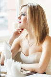 A woman is sitting in the restaurant Royalty Free Stock Photos