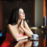 Beautiful woman sitting in the restaurant with a cup of coffee Stock Photo
