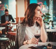 Beautiful woman sitting at the restaurant royalty free stock photos