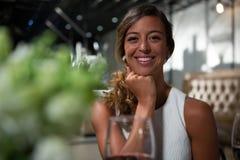Beautiful woman sitting restaurant. Portrait of beautiful women sitting restaurant Stock Photography