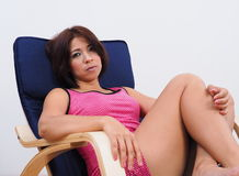 Beautiful woman sitting on rocking chair Stock Photography