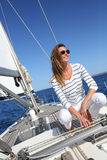 Beautiful woman sitting on sailing deck Royalty Free Stock Images