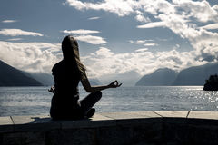 Beautiful woman is sitting on the sea-front, Norway stock photos