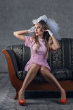 Beautiful woman sitting on sofa Royalty Free Stock Photos