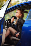 Beautiful fashion woman in a car Royalty Free Stock Images