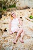 Beautiful woman sitting on the stone Stock Image