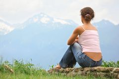 Beautiful woman is sitting on a stones Royalty Free Stock Photography