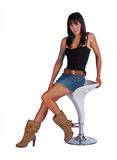 Beautiful woman sitting on a stool Stock Photos