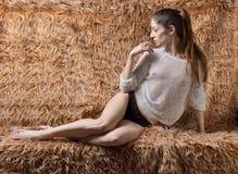 Beautiful woman sitting in Studio on furs. Royalty Free Stock Image