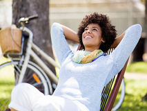 Beautiful woman sitting in summer park Stock Photography