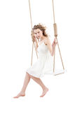 Beautiful woman sitting on swing isolated Royalty Free Stock Photography