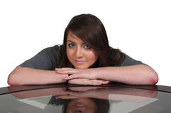 Beautiful Woman Sitting at Table Royalty Free Stock Images