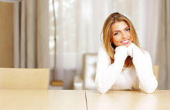 beautiful woman sitting at the table Royalty Free Stock Images