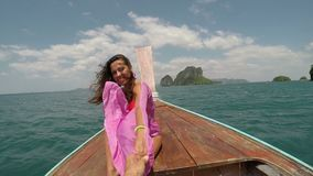 Beautiful woman sitting on thailand boat laughing holding man hand pov action camera, tourist couple on vacation stock video footage