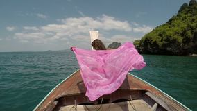 Beautiful Woman Sitting On Thailand Boat Nose Action Camera POV, Raising Hand Back Rear View Of Young Girl stock video