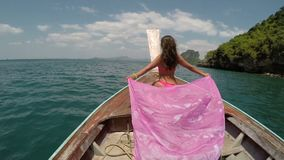 Beautiful Woman Sitting On Thailand Boat Nose Action Camera POV, Raising Hand Back Rear View Of Young Girl stock footage