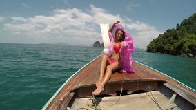 Beautiful Woman Sitting On Thailand Boat Nose Action Camera POV, Raising Pink Pareo Young Girl Happy Smiling stock video