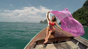 Beautiful Woman Sitting On Thailand Boat Nose Action Camera POV, Raising Pink Pareo Young Girl Happy Smiling stock video footage