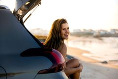 Girl near the beach sitting on the car Royalty Free Stock Photos