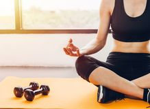 Beautiful woman sitting yoga on hands after exercise workout stock photography