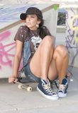 Beautiful woman in a skate park with skateboard Royalty Free Stock Images