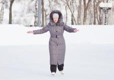 Beautiful woman is skating Stock Image