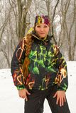 Beautiful woman in ski suit in snowy winter Stock Photography
