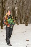 Beautiful woman in ski suit in snowy winter Royalty Free Stock Photography