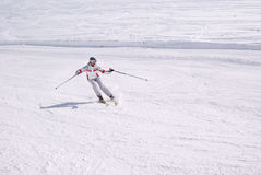 Beautiful woman skiing from downhill Royalty Free Stock Photography