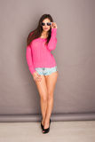Beautiful woman in skimpy shorts Royalty Free Stock Image
