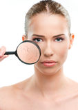 Beautiful woman, skin close up with a magnifying glass Stock Images