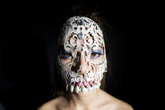 Beautiful woman with skull mask Royalty Free Stock Photography