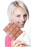 Beautiful woman with a slab of chocolate Stock Images