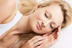 Beautiful woman sleeping. Portrait of beautiful woman sleeping on the bed Stock Image