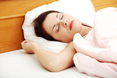 Beautiful woman sleeping in bed. Stock Photos