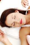 Beautiful woman sleeping in bed. Royalty Free Stock Photos